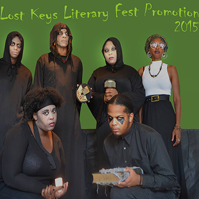 "The Fringe Marketing Group. Picture of the Chameleon Village Theatre featuring CEO Noelle Brooks in front of a green screen, dressed in all black. The words, ""The Lost Keys Festival Promotion 2015"" up top."