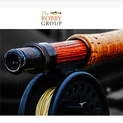 The Fringe Marketing Group of Macon-Web Development. Picture from The Robby Group front page. Upclose shot of the end of a fishing rod and the Robby Group logo above it.